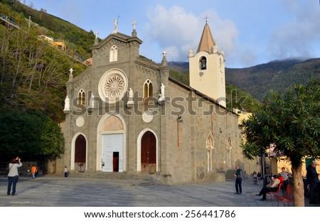 RIOMAGGIORE, ITALY - NOVEMBER 8: Church of St Giovanni Battista in  Riomaggiore. It is one of villages of Cinque Terre in Italy, suspended between sea and land. Riomaggiore, Italy - Nov 8, 2014 - stock photo