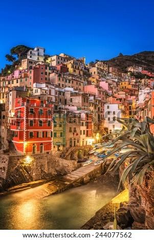 Riomaggiore Village, Cinque Terre, Italy, effect sunset - stock photo