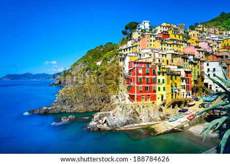 Riomaggiore village on cliff rocks and sea at sunset., Seascape in Five lands, Cinque Terre National Park, Liguria Italy Europe. Square format. Long Exposure - stock photo