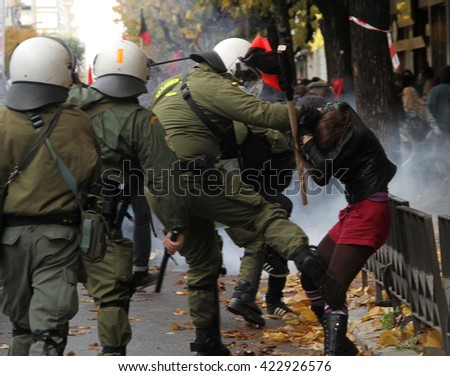 Riot police officers arrest youths during renewed clashes in the city centre streets on December 06, 2004 in Thessaloniki, Greece.