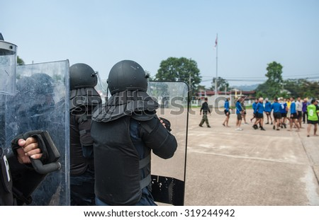 Riot police used shields and batons tactical training.  - stock photo