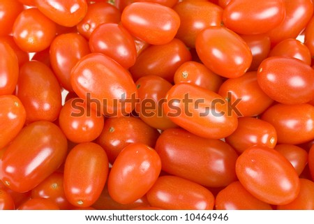 Ripe and fresh small tomatos background; close up