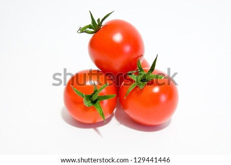 Ripe and juicy tomato over white background - stock photo