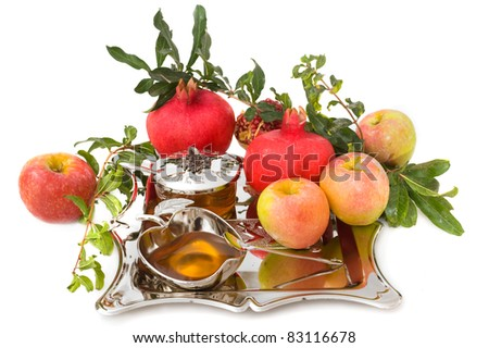ripe apple  ,pomegranates with leaves and honey for Rosh Hashana– jewish new year - stock photo