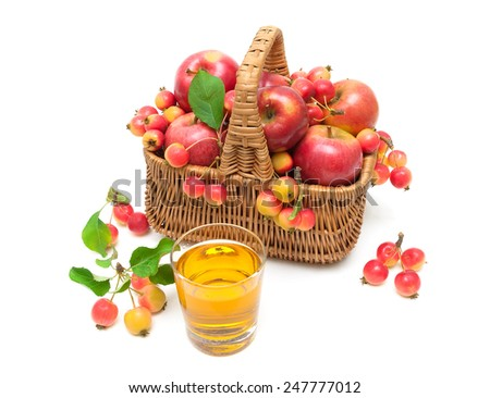 ripe apples in a wicker basket and a glass of juice isolated on white background. horizontal photo. - stock photo