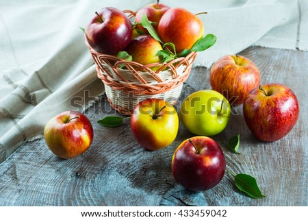 Ripe apples in the basket on the wooden table. Fresh fruits. Fresh apples. Healthy food. Healthy eating. Vegetarian food. Healthy eating concept.  - stock photo