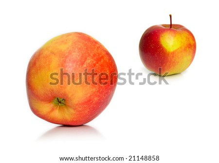 Ripe apples on a white background. Shallow DOF.