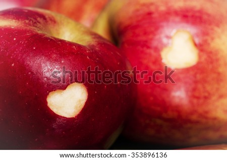 Ripe apples with hearts on wooden table, close-up. Healthy eating, life concept.  GMO free genetically modified organisms. Healthy fruits. - stock photo