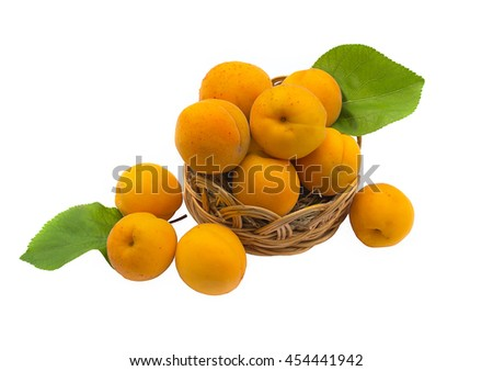 Ripe apricots in a wicker basket isolated on white background - stock photo