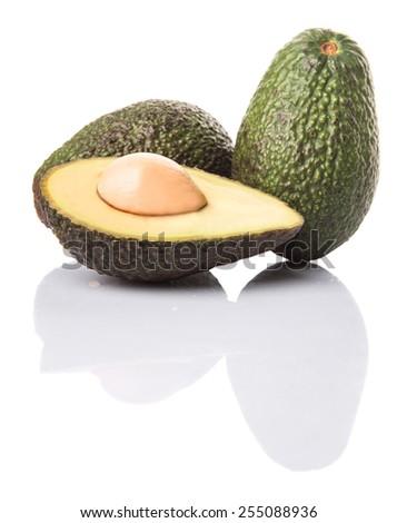 Ripe avocado fruit over white background - stock photo