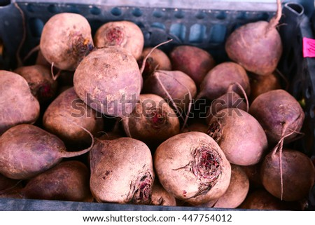 ripe beetroots lay in box on the market