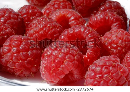 Ripe berries on a plate - stock photo