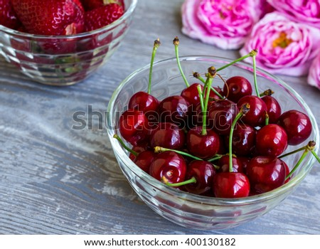 Ripe cherries and strawberries on the table