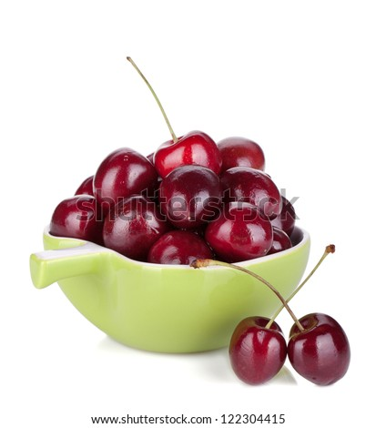 Ripe cherries in a bowl. Isolated on white background