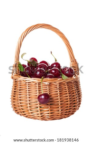 Ripe cherries in a wattled basket, it is isolated on a white background