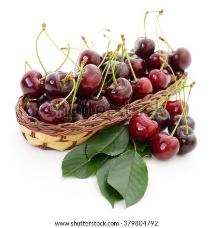 Ripe cherries in basket on a white background. - stock photo