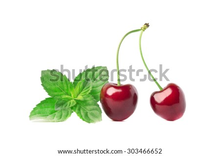 Ripe cherry and fresh mint - stock photo