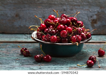 Ripe cherry in a vintage bowl - stock photo