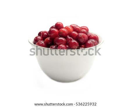 Ripe cranberries in round white bowl isolated on white background indoor front view close up