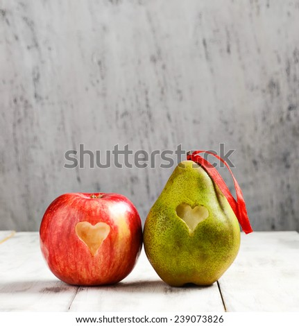 Ripe fresh apple and pear with heart for Valentine day - stock photo