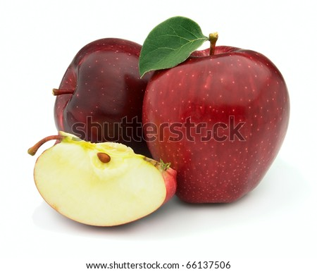 Ripe fresh apples with leaves - stock photo