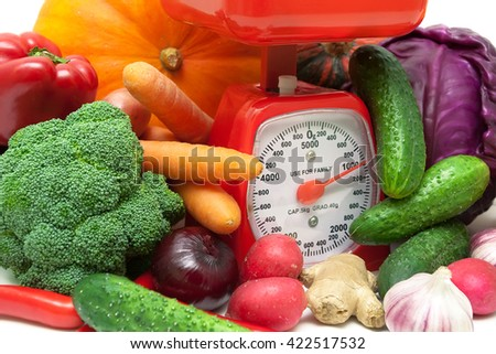 ripe fresh vegetables and kitchen scale closeup. horizontal photo. - stock photo