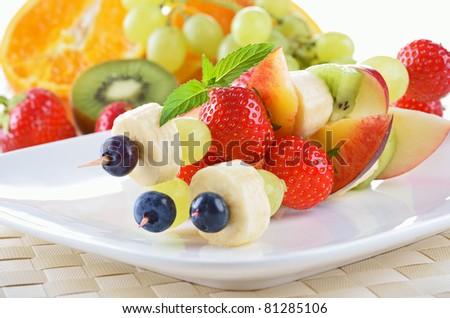 Ripe fruit in season on skewers - stock photo