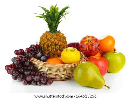 Ripe fruits in basket isolated on white - stock photo
