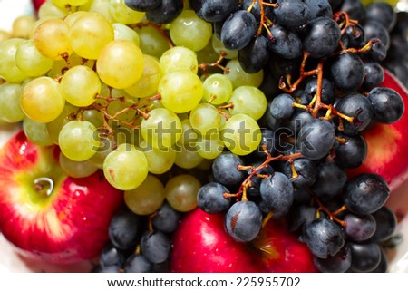 ripe grape and juicy apple as illustration collection harvest - stock photo