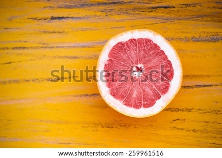 Ripe Grapefruit On A Unusual Yellow Background Top View - stock photo