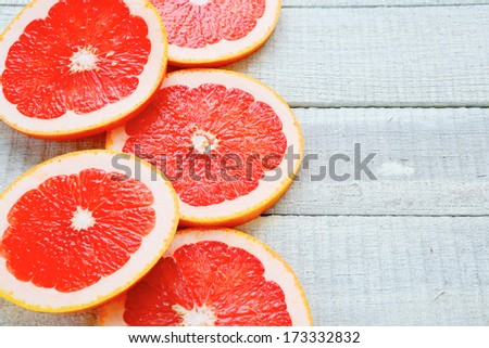 ripe grapefruit on white boards, food closeup - stock photo