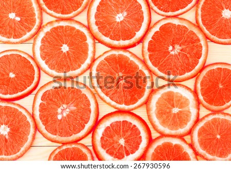 ripe grapefruit on white boards, food closeup (seen from above)