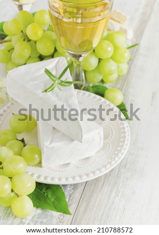 ripe grapes, brie cheese and a glass of wine.health and diet food. selective focus - stock photo