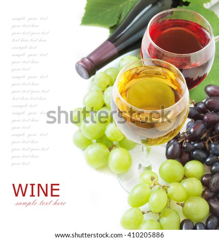 Ripe grapes, white and red wine glasses and bottles of wine isolated on white - stock photo