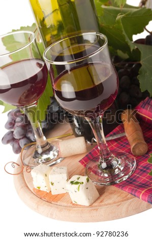 Ripe grapes, wine glass and bottle of wine - stock photo