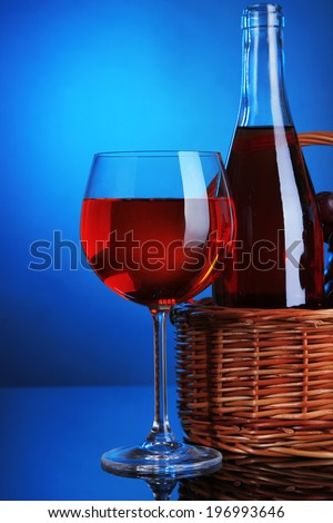 Ripe grapes, wine glass and bottle of wine on colorful background - stock photo