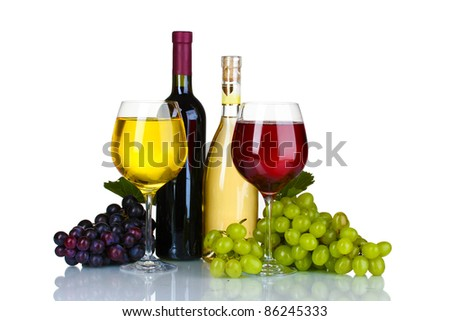 Ripe grapes, wine glasses and bottles of wine isolated on white - stock photo
