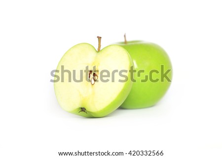 Ripe green apple and slice isolated on a white background