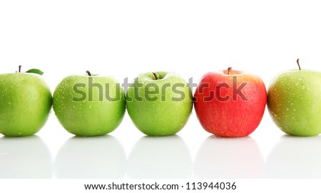 Ripe green apples and one red apple isolated on white