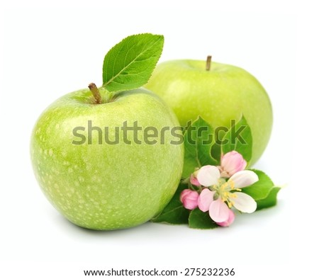 Ripe green apples fruit with leaves close up on white - stock photo