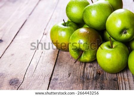 Ripe green apples on wooden background - stock photo