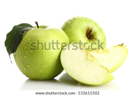 Ripe green apples with leaf and slice, isolated on white - stock photo