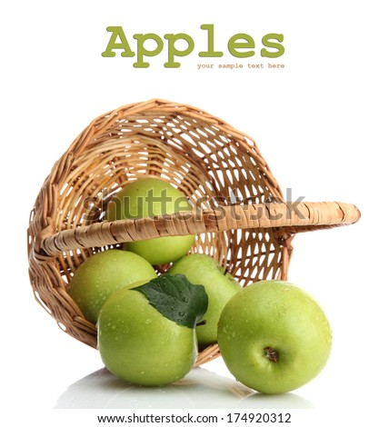 Ripe green apples with leaves in basket isolated on white - stock photo