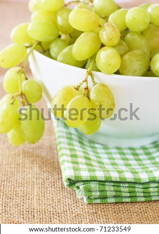 Ripe green grapes in a bowl - stock photo