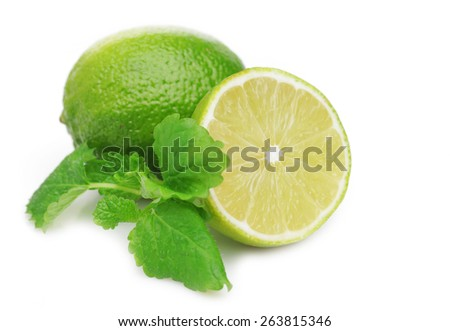 Ripe green lime with young green leaves isolated on white background. - stock photo