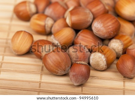 Ripe hazelnuts on the wooden table