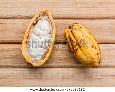 Ripe Indonesia's cocoa  setup on rustic wooden background. - stock photo