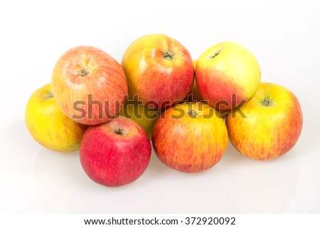 Ripe juicy apples on a white background, harvest from the garden, apple diet to slim figure, vitamin dessert - stock photo