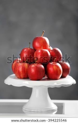 Ripe juicy apples on white plastic tray - stock photo