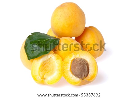 ripe juicy apricots on white background - stock photo
